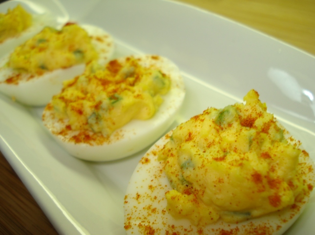 Four Devilled Eggs on a plate