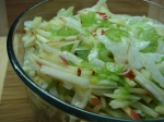 Coleslaw in glass bowl on bamboo mat