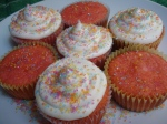 Pink Cupcakes with Vanilla Icing and coloured sugar sprinkles