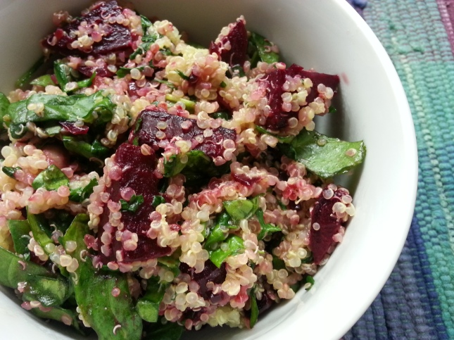 Beet and quinoa salad with wilted spinach