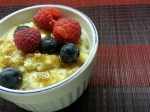 Quinoa Oatmeal in bowl with fruit and brown sugar
